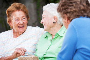 Three elderly women talking